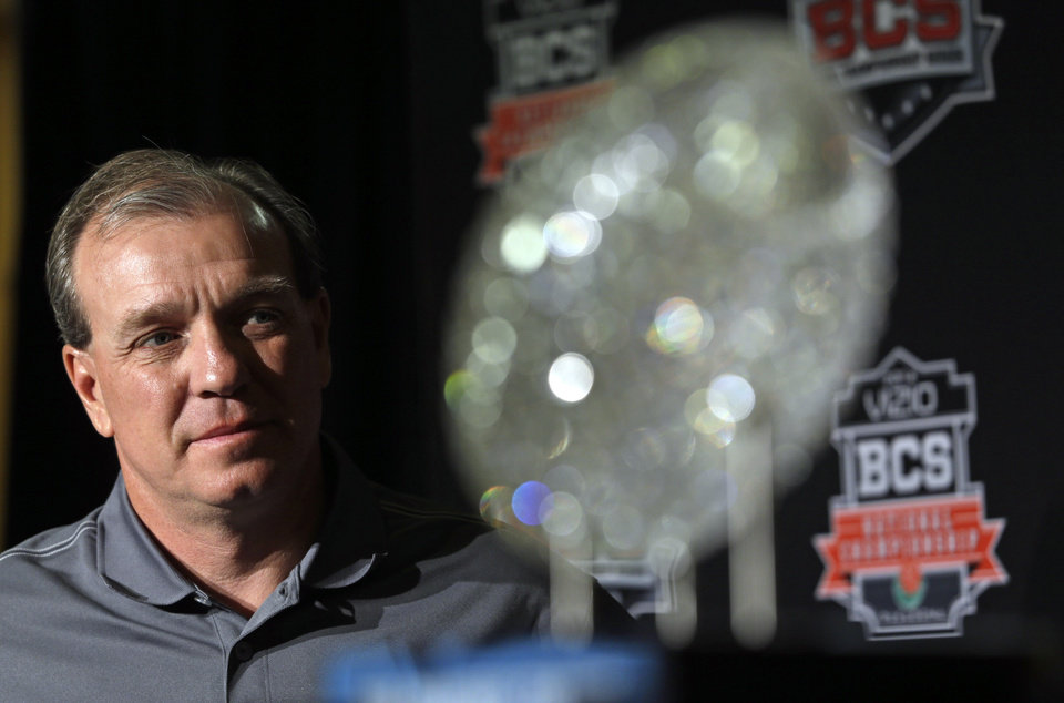 Photo - Florida State head coach Jimbo Fisher poses with The Coaches' Trophy during a news conference for the BCS National Championship NCAA college football game Tuesday, Jan. 7, 2014, in Newport Beach, Calif. Florida State beat Auburn 34-31 to win the championship the night before. (AP Photo/David J. Phillip)