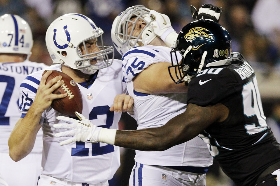 Photo -   Jacksonville Jaguars defensive end Andre Branch (90) pressures Indianapolis Colts quarterback Andrew Luck, left, as guard Mike McGlynn (75) blocks during the first half of an NFL football game, Thursday, Nov. 8, 2012, in Jacksonville, Fla. (AP Photo/John Raoux)