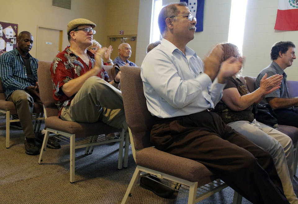 In this Sunday, Aug. 18, 2013 photo, Pentecostal members attend a service at The Three Crosses Church in Chatsworth area of Los Angeles. The 40-member church is among others nationwide that is reducing or cutting out speaking in tongues in an attempt to be more mainstream, a shift that unsettled some parishioners who say the practice is at the heart of the movement. (AP Photo/Sarah Parvini)