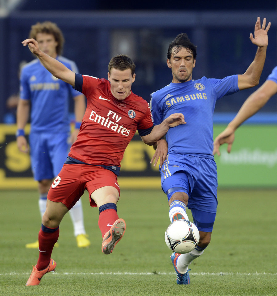 Photo -   Chelsea FC's Paolo Ferreira, right, and Paris Saint-Germain's Kevin Gameiro go for the ball during the first half of their exhibition soccer match at Yankee Stadium in New York, Sunday, July 22, 2012. (AP Photo/Henny Ray Abrams)