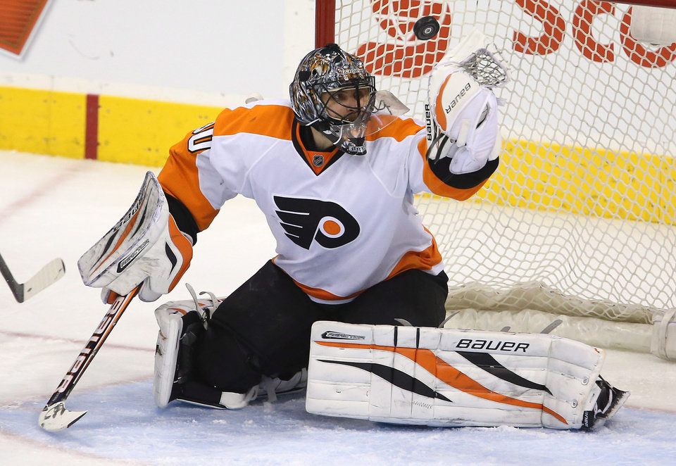 Photo - Philadelphia Flyers goaltender Ilya Bryzgalov juggles a puck shot by Winnipeg Jets' Nik Antropov (80) on a breakaway attempt  during the second period of an NHL hockey game in Winnipeg, Manitoba, Tuesday, Feb. 12, 2013. (AP Photo/The Canadian Press, Trevor Hagan)