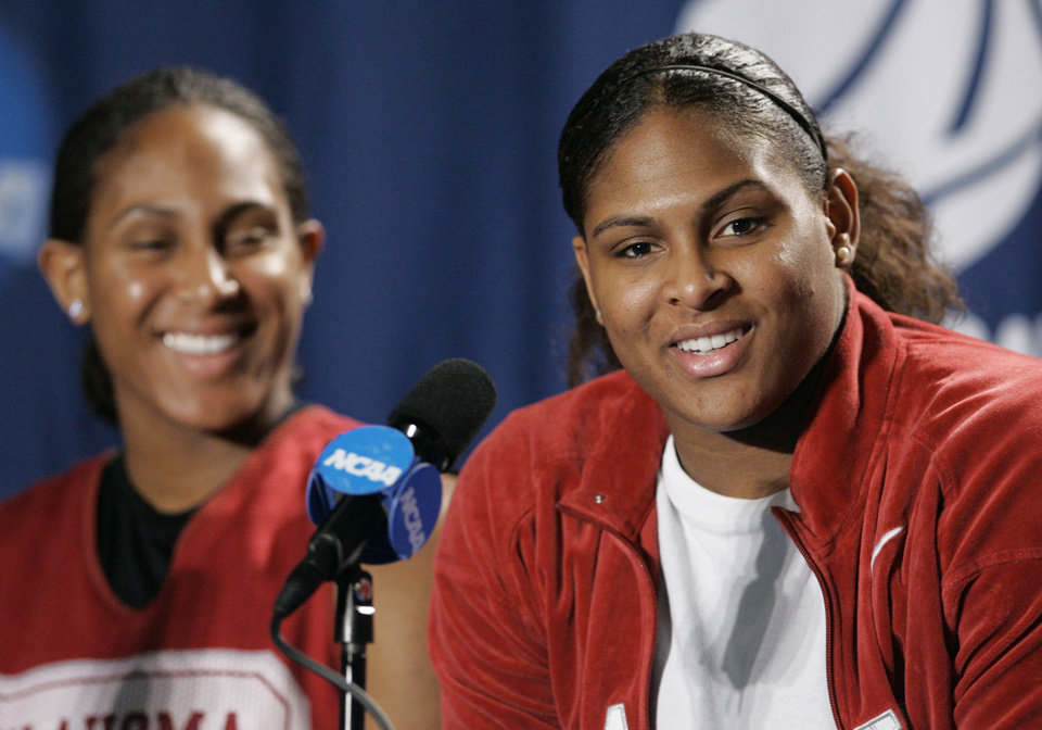 OU / ELITE 8 / ELITE EIGHT: University of Oklahoma's Courtney Paris, right, and her sister Ashley Paris during a news conference for the NCAA tournament regional women's college basketball regional game in Oklahoma City, Monday, March 30, 2009.  (AP Photo/Donna McWilliam) ORG XMIT: OKA103