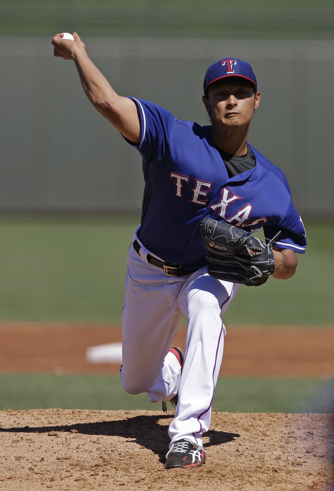 Photo - Texas Rangers starting pitcher Yu Darvish, of Japan, throws during the third inning of a spring exhibition baseball game against the Cincinnati Reds, Monday, March 10, 2014, in Suprise, Ariz. (AP Photo/Darron Cummings)