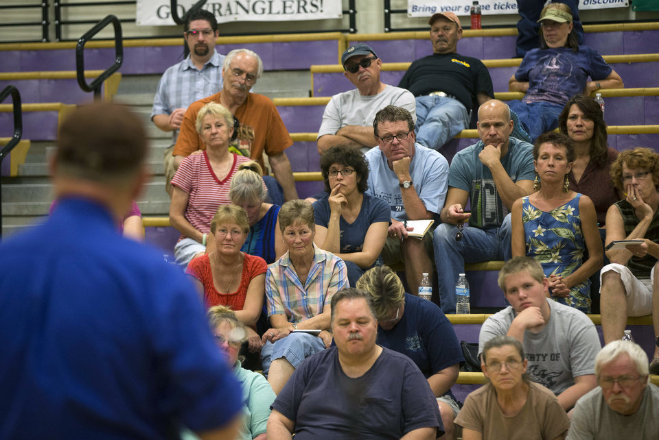 Photo - Evacuees from Yarnell and Glen Ilah, Ariz. listen during a community meeting at the Red Cross Shelter in Wickenburg, Ariz. on Saturday, July 6, 2013. Nineteen Granite Mountain Hotshot firefighters were killed by the out-of-control blaze near Yarnell, Ariz. on June 30. (AP Photo/The Arizona Republic, Michael Chow)