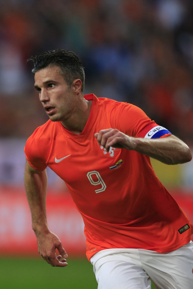 Photo - Netherlands' captain Robin van Persie runs to the midfield after scoring 1-1 during the international friendly soccer match between Netherlands and Ecuador at ArenA stadium in Amsterdam, Netherlands, Saturday, May 17, 2014. (AP Photo/Peter Dejong)