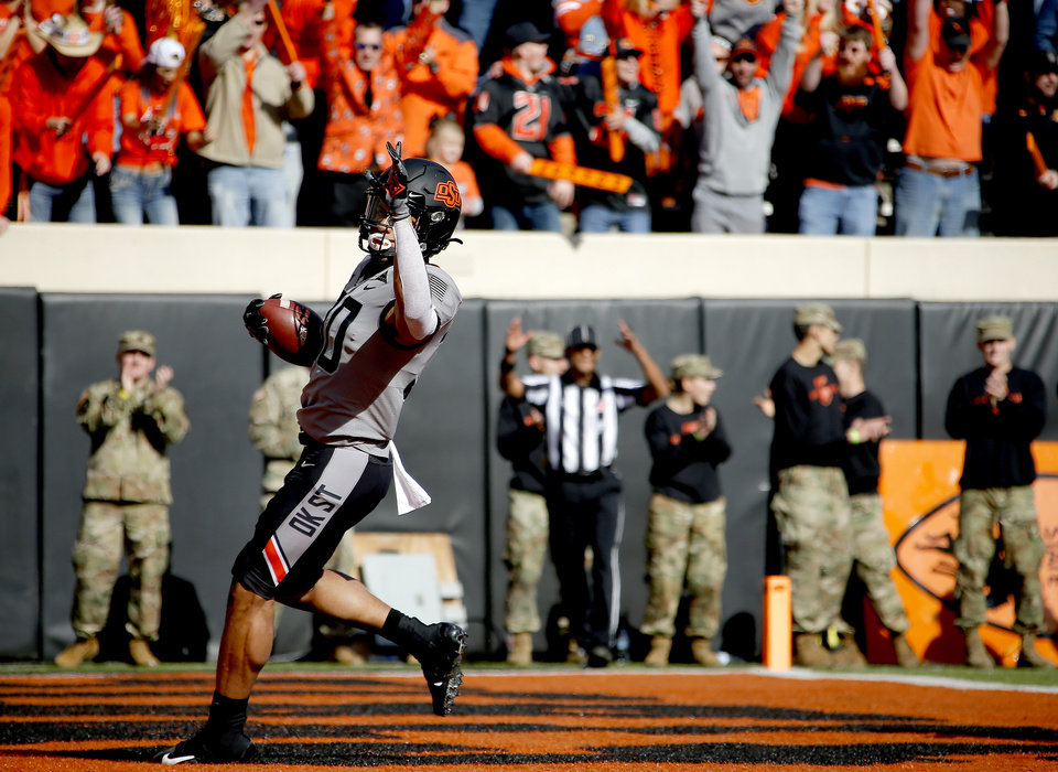 Photo - Oklahoma State's Chuba Hubbard (30) reacts after a touchdown in the first quarter during the college football game between the Oklahoma State University Cowboys and the Kansas Jayhawks at Boone Pickens Stadium in Stillwater, Okla., Saturday, Nov. 16, 2019.  [Sarah Phipps/The Oklahoman]