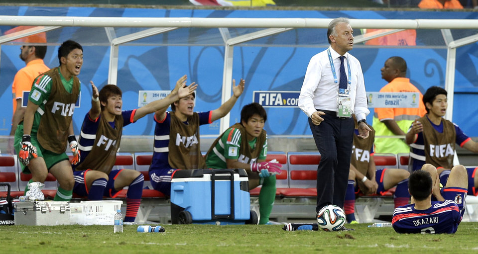 Photo - Japan's head coach Alberto Zaccheroni, stands on the touchline as his bench appeal for a foul during the group C World Cup soccer match between Japan and Colombia at the Arena Pantanal in Cuiaba, Brazil, Tuesday, June 24, 2014. (AP Photo/Thanassis Stavrakis)