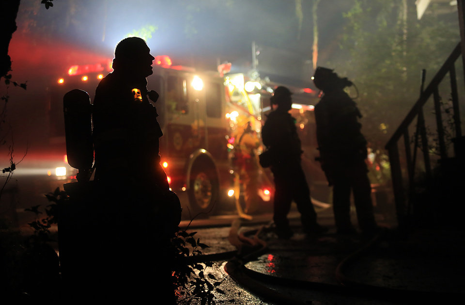Fire crews respond to a fire that damaged a home on Wednesday May 1, 2013 in Knights Valley, Calif.  Crews battled two small wildfires on Wednesday in California wine country that were pushed by gusty winds. (AP Photo/The Press Democrat, Kent Porter)
