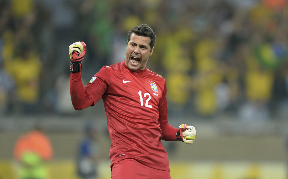 Photo - FILE - In this June 26, 2013 file photo, Brazil's Julio Cesar celebrates his team's 2-1 victory at a Confederations Cup semifinal soccer match with Uruguay in Belo Horizonte, Brazil. Cesar is the weakest link in the national team which all of Brazil expects to win the 2014 World Cup. That is no accident: Brazil has long paid far more attention to players who score and make goals than to those who save them. (AP Photo/Eugenio Savio, File)