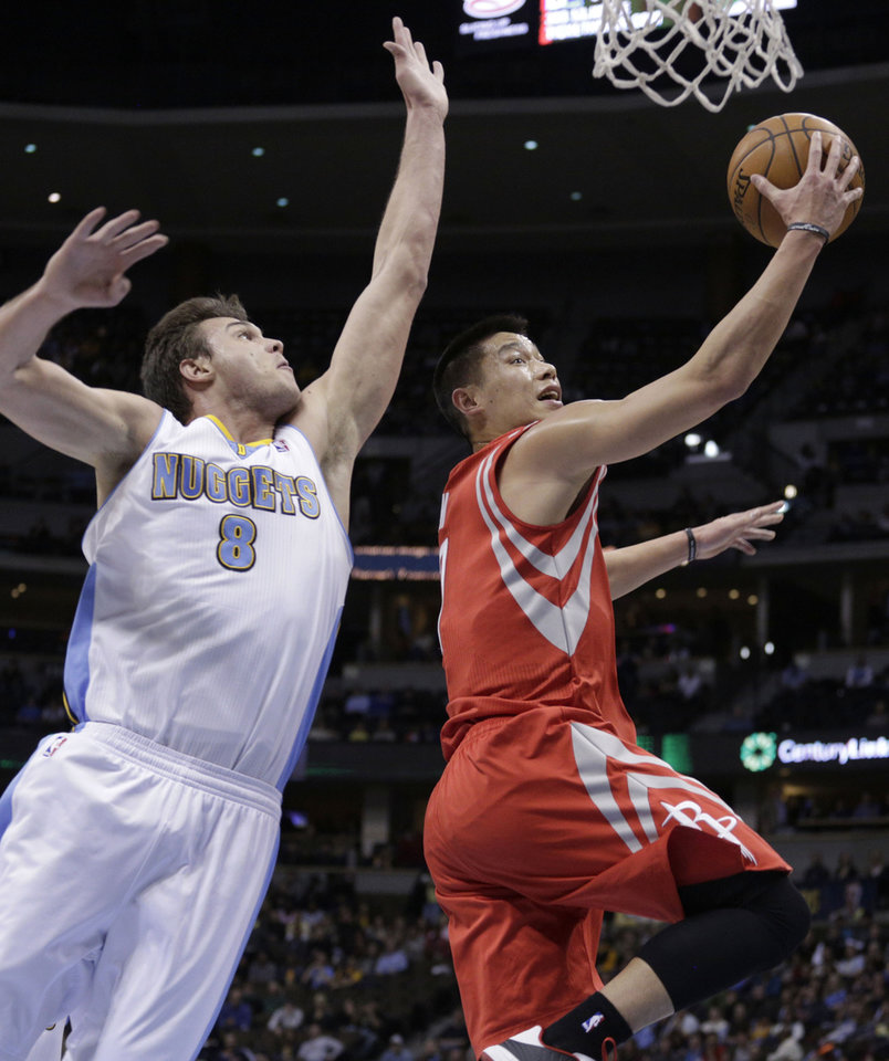Denver Nuggets' Danilo Gallinari (8), of Italy, guards Houston Rockets' Jeremy Lin during the first quarter of an NBA basketball game, Wednesday, Jan. 30, 2013, in Denver. (AP Photo/Joe Mahoney)