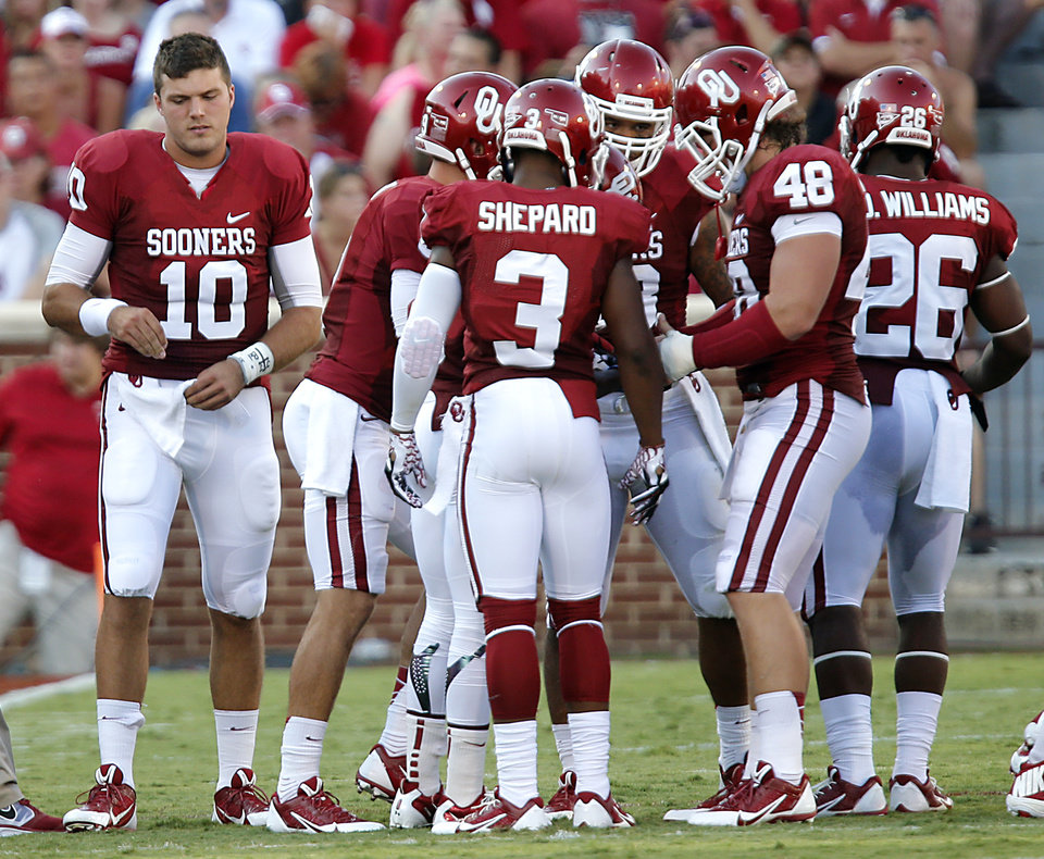 Photo - Oklahoma's Blake Bell (10) walks away from the offensive huddle during the college football game between the University of Oklahoma Sooners (OU) and the University of Louisiana Monroe Warhawks (ULM) at the Gaylord Family Memorial Stadium on Saturday, Aug. 31, 2013 in Norman, Okla.  Photo by Chris Landsberger, The Oklahoman