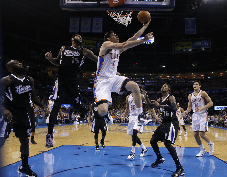 Oklahoma City\'s Nick Collison (4) shoots a basket in front of Sacramento\'s Quincy Acy (5), DeMarcus Cousins (15) and Ben McLemore (16) during the NBA game between the Oklahoma City Thunder and the Sacramento Kings at the Chesapeake Energy Arena, Sunday, Jan. 19, 2014. Photo by Sarah Phipps, The Oklahoman