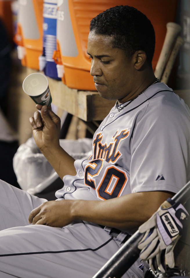 Photo -   Detroit Tigers pitcher Octavio Dotel tosses a cup in the dugout after he was pulled in the ninth inning of a baseball game against the Seattle Mariners, Monday, May 7, 2012, in Seattle. Dotel was charged with the loss as the Mariners beat the Tigers, 3-2. (AP Photo/Ted S. Warren)