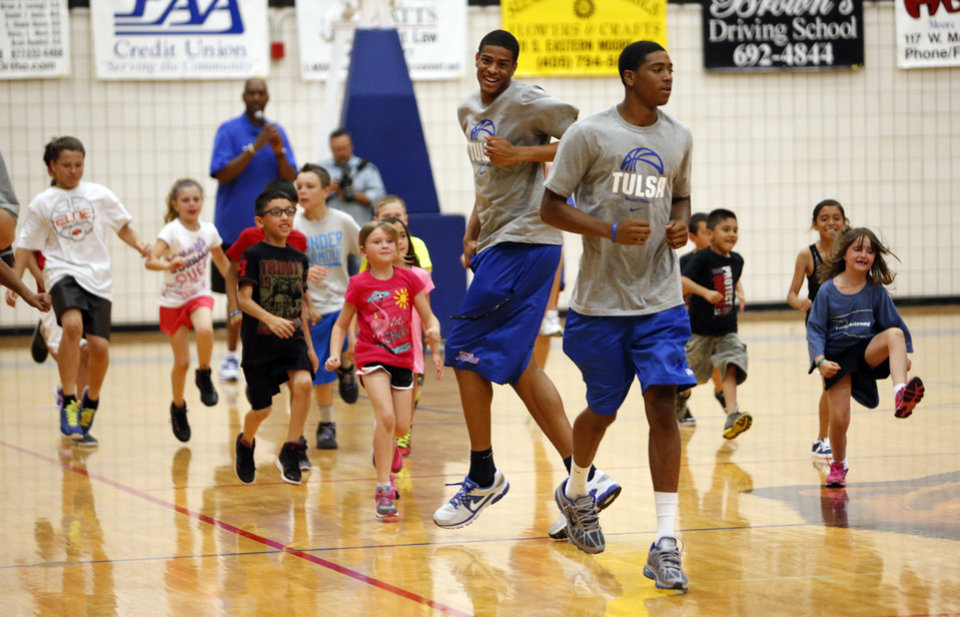 Current University of Tulsa basketball players lead drills as former NBA All-Stars Danny Manning, Otis Birdsong and Michael Ray Richardson host a basketball clinic for tornado victims on Thursday, June 13, 2013 in Moore, Okla.  Photo by Steve Sisney, The Oklahoman