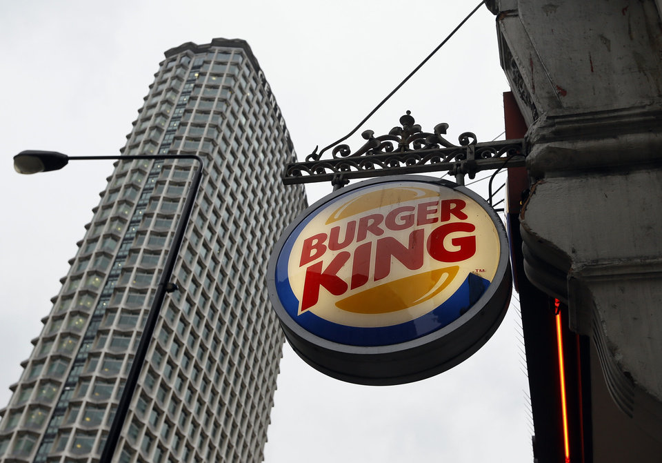 A sign hangs at a branch of Burger King in central London, Thursday, Jan. 24, 2013. Burger King says it has stopped buying beef from an Irish supplier whose patties in Britain and Ireland were found to contain traces of horsemeat. Officials say there is no risk to human health, but the episode has raised food security concerns. (AP Photo/Kirsty Wigglesworth)