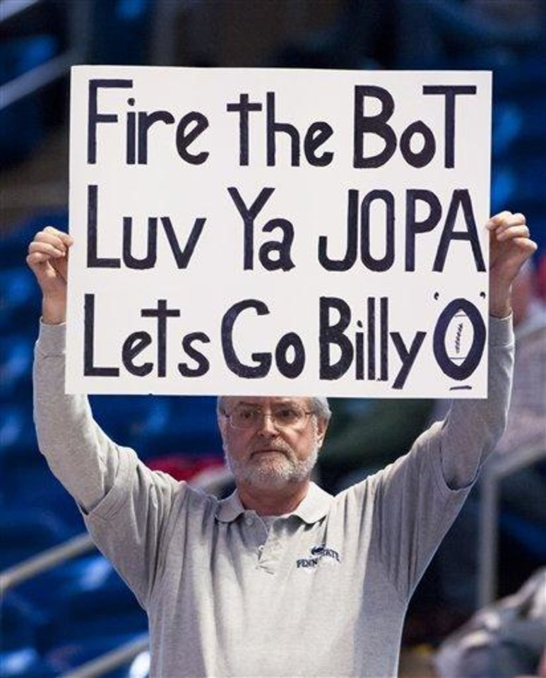 Gary Shildt, a Penn State alumnus, holds up a sign in protest of the Penn State board of trustees and in support of former Penn State football coach Joe Paterno and newly named coach Bill O'Brien, during an NCAA college basketball game in State College, Pa., Thursday, Jan. 19, 2012. (AP Photo/Andy Colwell)