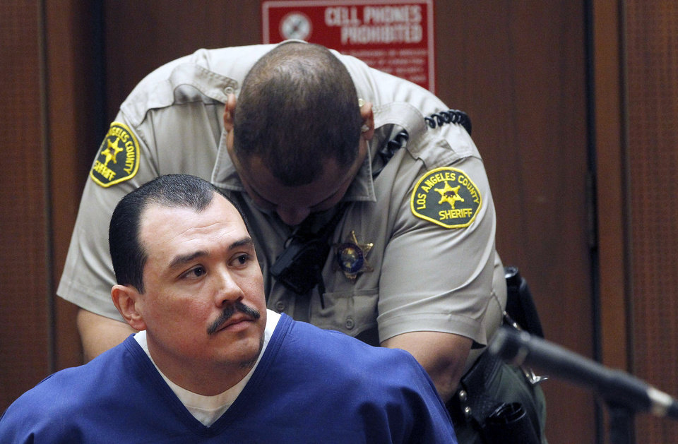 Photo - Defendant Louie Sanchez sits in court during a hearing Thursday Feb. 20, 2014 in Los Angeles. Sanchez and co-defendant, Marvin Norwood  pleaded guilty Thursday to a 2011 beating at Dodger Stadium that left San Francisco Giants fan Bryan Stow brain damaged and disabled. They were immediately sentenced by an angry judge who called them cowards and the sort of people that sports fans fear when they go to games.(AP Photo/Nick Ut )