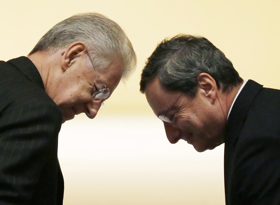 Italian Prime minister Mario Monti, left, and European Central bank President Mario Draghi meet as they attend the opening ceremony of the academic year of the Bocconi University in Milan, Italy, Thursday, Nov. 15, 2012. The 17-country eurozone has fallen back into recession for the first time in three years as the fallout from the region�s financial crisis was felt from Amsterdam to Athens. And with surveys pointing to increasingly depressed conditions across the eurozone at a time of high unemployment in many countries, there are fears that the recession will deepen, and make the debt crisis _ calmer of late _ even more difficult to handle.(AP Photo/Antonio Calanni)