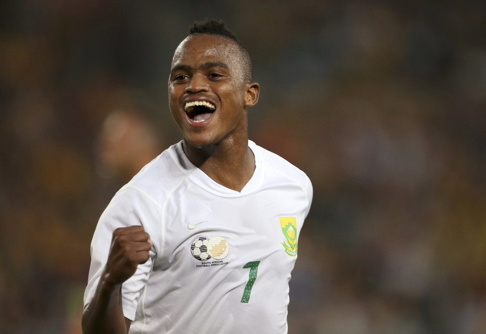 Photo - South Africa's Ayanda Patosi celebrates scoring against Australia during their friendly soccer match in Sydney, Monday, May 26, 2014. (AP Photo/Rick Rycroft)