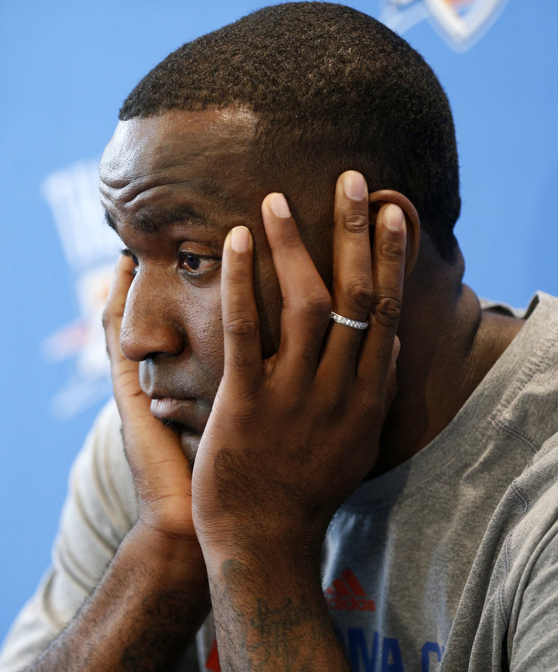 Photo - Kendrick Perkins during exit interviews with the media for the Oklahoma City Thunder at the team's practice facility in Oklahoma City, Sunday, June 1, 2014. PHOTO BY NATE BILLINGS, The Oklahoman