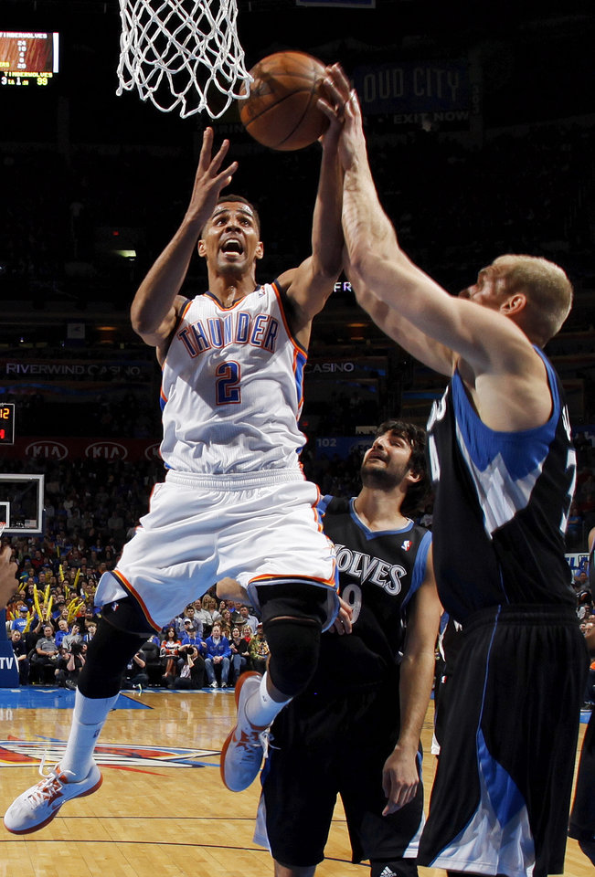 Oklahoma City\'s Thabo Sefolosha (2) moves to the hoop against Minnesota\'s Greg Stiemsma (34) in front of Ricky Rubio (9) during an NBA basketball game between the Oklahoma City Thunder and Minnesota Timberwolves at Chesapeake Energy Arena in Oklahoma City, Friday, Feb. 22, 2013. Oklahoma City won, 127-111. Photo by Nate Billings, The Oklahoman