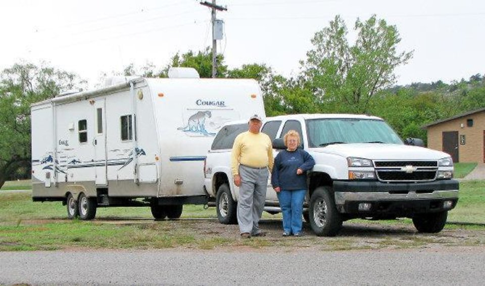 Gary and Linda Haas in front of their pickup and trailer in an undated photo taken at Great Plains State Park in Oklahoma. Photo provided by the family to the Countywide and Sun of Tecumseh. ORG XMIT: KOD <strong>Provided</strong>