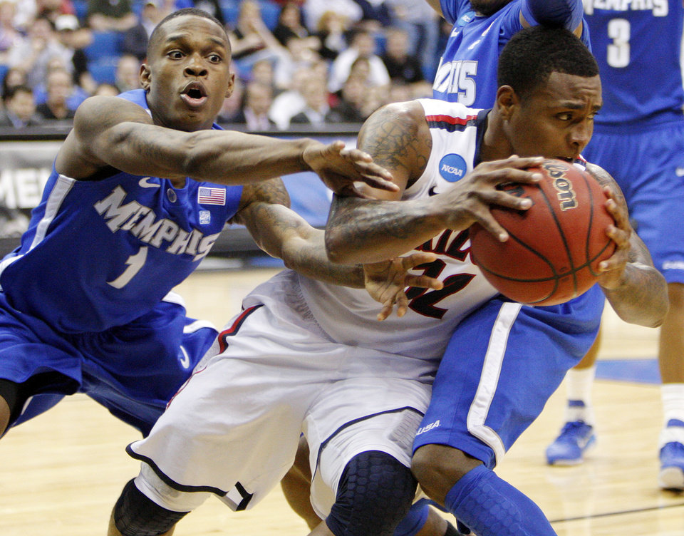 Photo - Joe Jackson (1) of Memphis tries to steal the ball from Lamont Jones (12) of Arizona in the second half during the NCAA men's basketball tournament second round game between Arizona and Memphis at the BOK Center in Tulsa, Okla., Friday, March 18, 2011. Arizona won, 77-75. Photo by Nate Billings, The Oklahoman