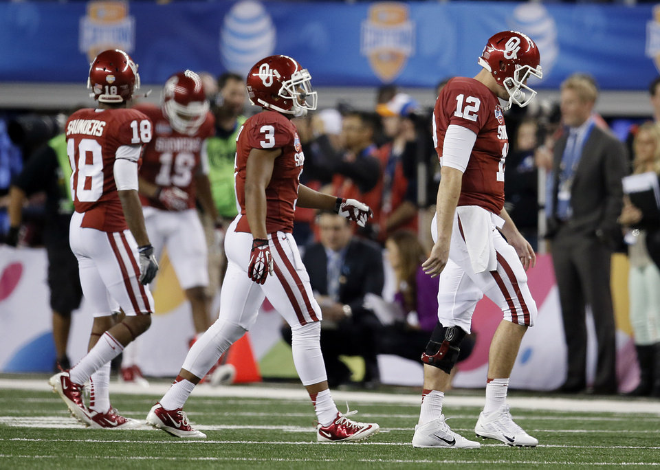 Oklahoma\'s Justin Brown (19), Jalen Saunders (18), Sterling Shepard (3) and Landry Jones (12) walk off the field after being stopped on a fourth down during the college football Cotton Bowl game between the University of Oklahoma Sooners (OU) and Texas A&M University Aggies (TXAM) at Cowboy\'s Stadium on Friday Jan. 4, 2013, in Arlington, Tx. Photo by Chris Landsberger, The Oklahoman