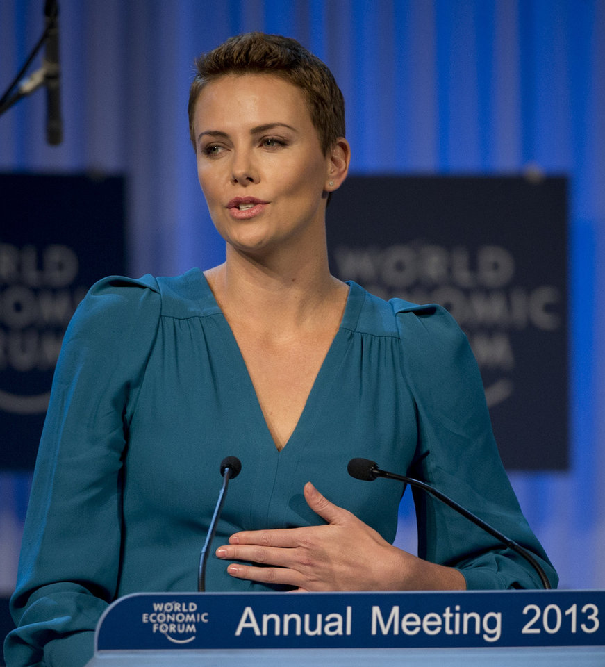 South African Academy Award-winning actress Charlize Theron accepts her Crystal award on the eve of the opening of the 43rd Annual Meeting of the World Economic Forum, WEF, in Davos, Switzerland, Tuesday, Jan. 22, 2013.  (AP Photo/Anja Niedringhaus)