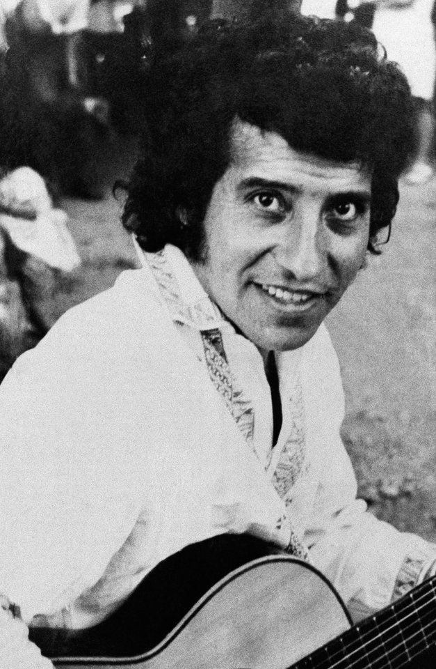 FILE - In this undated file photo, singer and songwriter Victor Jara poses for a photo in Chile. A Chilean court on Friday, Dec. 28, 2012, charged eight former army lieutenants in the killing of Jara almost four decades ago. Jara was detained along with many others at Chile\'s State Technical University the day after the Sept. 11, 1972 coup that toppled President Salvador Allende. His body was found several days later, riddled with bullets and bearing signs of torture. The killing transformed Jara into a symbol of struggle against Latin America\'s military right-wing dictatorships. (AP Photo, File)