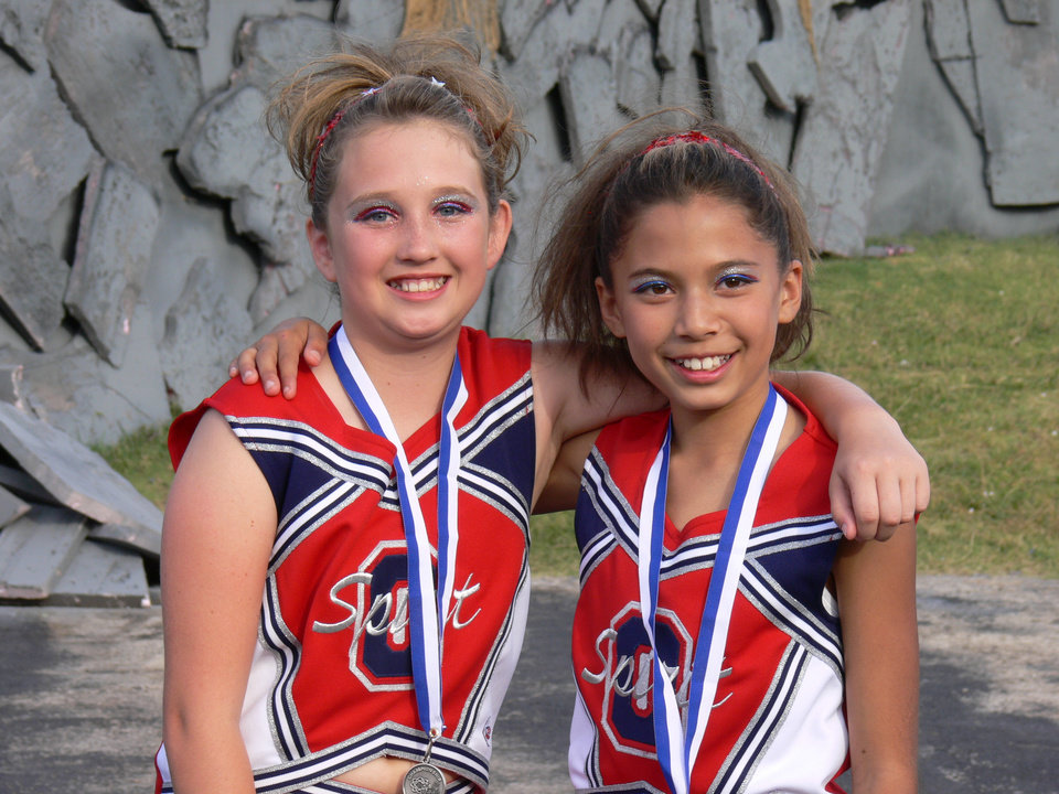 Kaitlin and Taylor.  After wining 1st place at Frontier City. MWC  Spirir of Oklahoma<br/><b>Community Photo By:</b> Jeff Graybill<br/><b>Submitted By:</b> Jeff, Midwest city