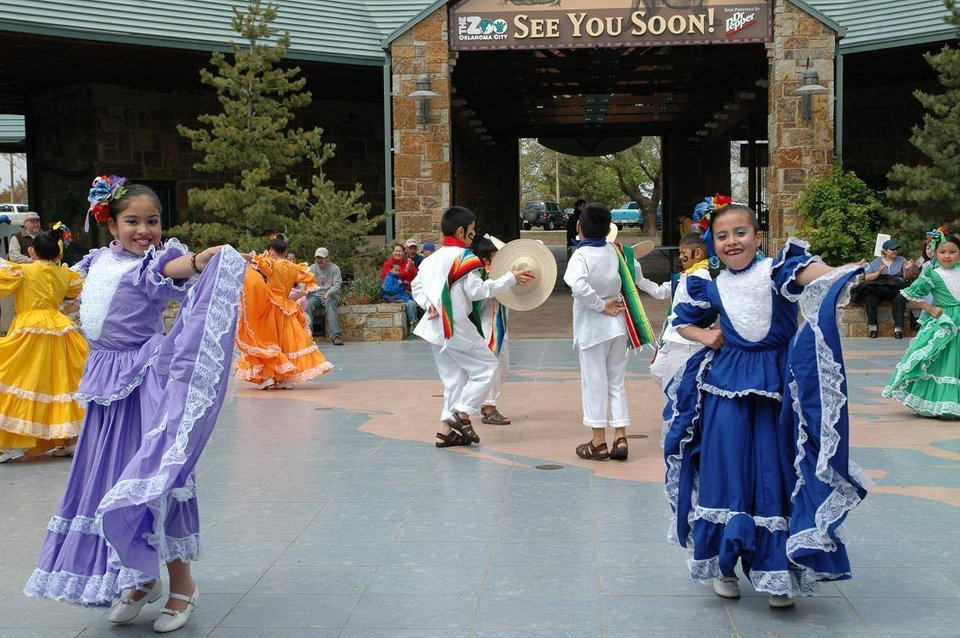 The Columbus Hispanic Folkloric Dancers from Columbus Enterprise Elementary in Oklahoma City perform a traditional Columbian dance at the Oklahoma City Zoo's Party for the Planet celebration Apr. 14.  The event celebrated conservation and diversity in the natural environment as part of Zoo and Aquarium Month.<br/><b>Community Photo By:</b> Mary Wagner<br/><b>Submitted By:</b> Mary, Oklahoma City
