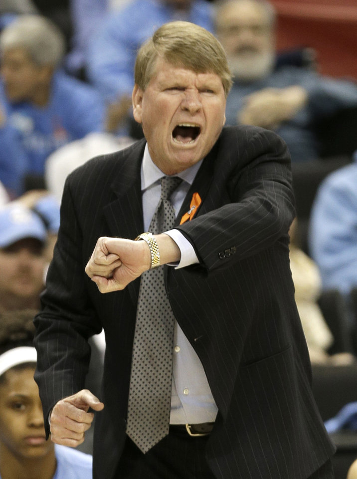 Photo - North Carolina associate head coach Andrew Calder argues a call during the first half of an NCAA college basketball game against Wake Forest in Winston-Salem, N.C., Thursday, Jan. 23, 2014. (AP Photo/Chuck Burton)