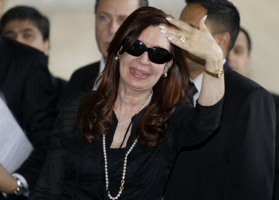 Argentina's President Cristina Fernandez gestures to journalists as she arrives to Hotel Nacional in Havana, Cuba, early Friday, Jan. 11, 2013. Fernandez is in Cuba to visit Venezuela's President Hugo Chavez, who is recovering from cancer surgery. (AP Photo/Franklin Reyes)