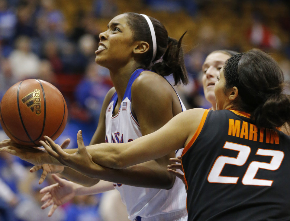 Photo - Kansas forward Chelsea Gardner, left, is fouled by Oklahoma State guard Brittney Martin (22) during the second half of an NCAA college basketball game in Lawrence, Kan., Wednesday, Jan. 22, 2014. Oklahoma State defeated Kansas 64-56.(AP Photo/Orlin Wagner)