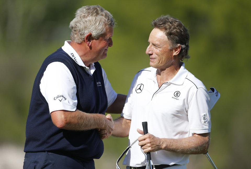 Photo - Bernhard Langer, right, congratulates Colin Montgomerie after the final round of the 75th Senior PGA Championship golf tournament at Harbor Shores Golf Club in Benton Harbor, Mich., Sunday, May 25, 2014. Montgomerie won the tournament. (AP Photo/Paul Sancya)