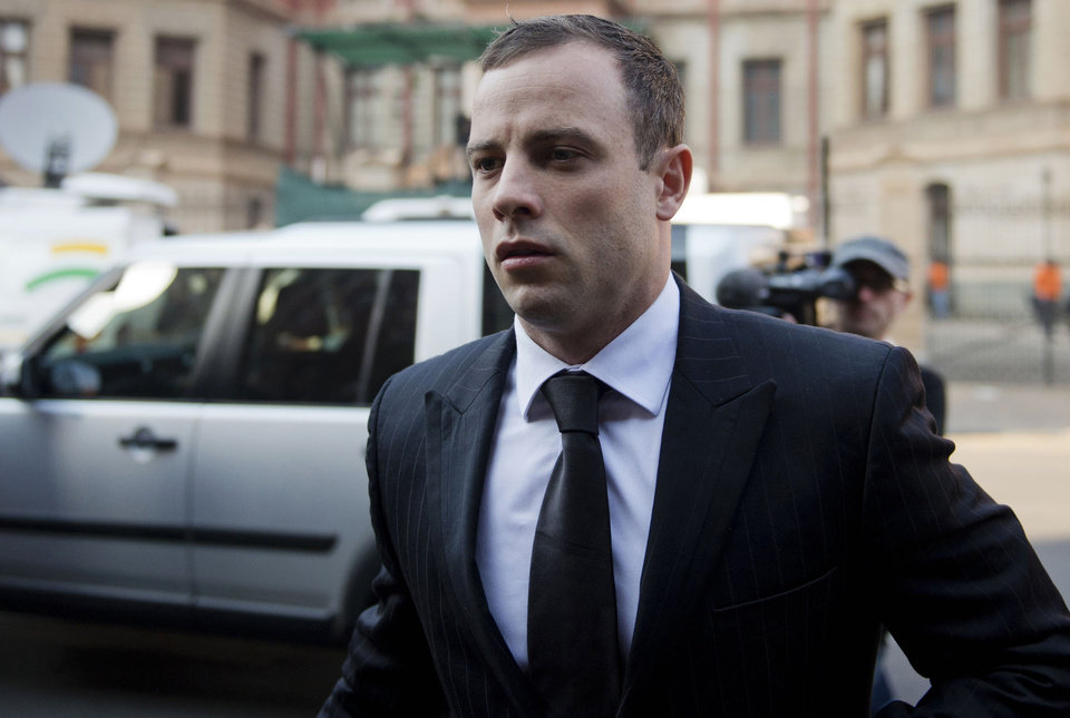 Photo - Oscar Pistroius arrives at court in Pretoria, South Africa, Monday, June 30, 2014. The murder trial resumed after one month during which mental health experts evaluated the athlete to determine if he has an anxiety disorder that could have influenced his actions on the night he killed his girlfriend Reeva Steenkamp. (AP Photo)