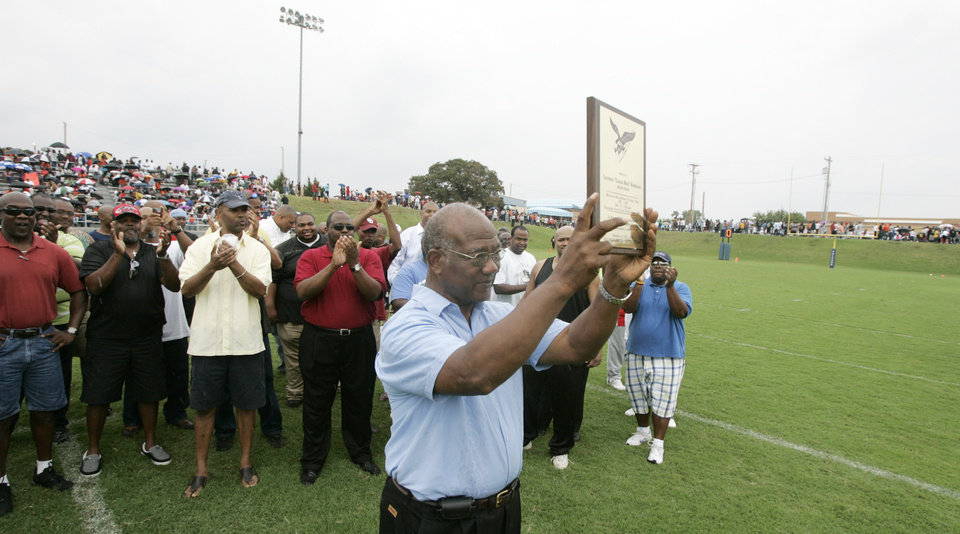 Photo -  Former Millwood head football coach Leodies Robinson holds a plaque during a halftime ceremony naming the football field after the legendary coach at Millwood High school in Oklahoma City, Oklahoma September 12, 2009. Photo by Steve Gooch, The Oklahoman