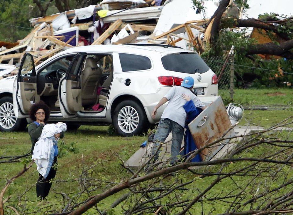 Photo - Residents are greeted by friends as they emerge from shelters after a tornado ripped through Bridge Creek, Okla. on Wednesday, May 6, 2015.  Photo by Steve Sisney, The Oklahoman