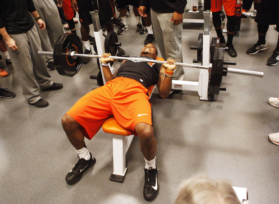 Photo - Receiver Tracy Moore lifts weights during a workout at Oklahoma State's pro day held at Boone Pickens Stadium in Stillwater on Thursday, March 13, 2014. Photo by KT King, The Oklahoman