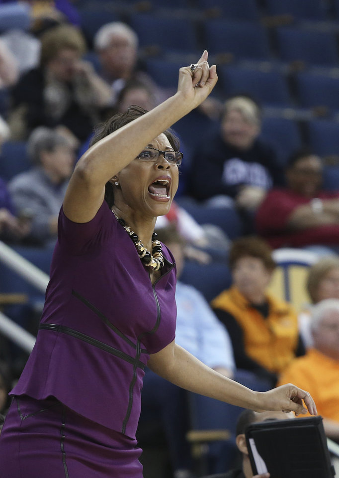 Photo - LSU coach Nikki Caldwell talks to her players during the first half of an NCAA college basketball game against Tennessee in the quarterfinals of the Southeastern Conference women's tournament, Friday, March 7, 2014, in Duluth, Ga. (AP Photo/Jason Getz)