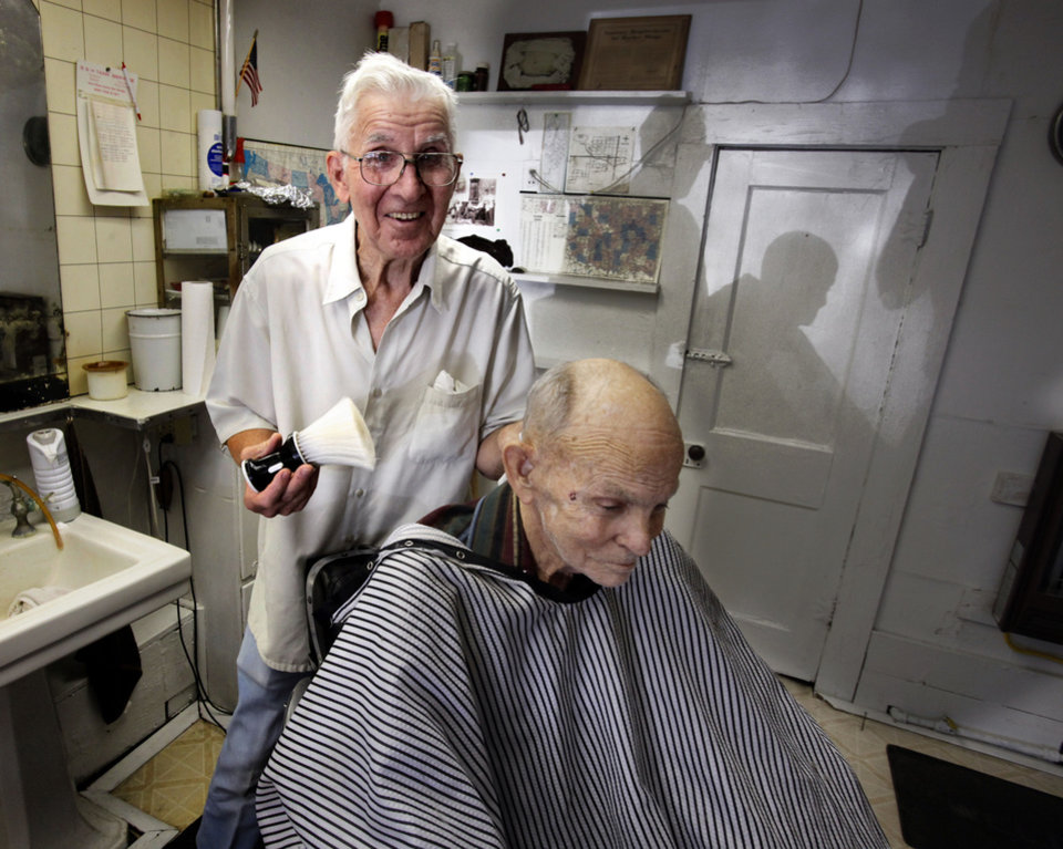 Barber John Adkins gives a haircut to Earl Tarrant, 72, in Adkins\' shop on Tuesday, July 31, 2012, in Maysville, Okla. Photo by Steve Sisney, The Oklahoman STEVE SISNEY