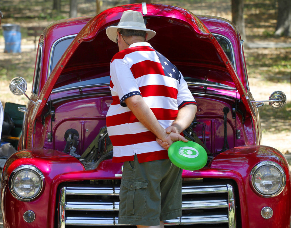 Harrell Denson looks at a 1953 GMC pick up truck at Freedom Festival at Eldon Lyon Park in Bethany, Wednesday, July 4, 2012. Photo By Steve Gooch, The Oklahoman