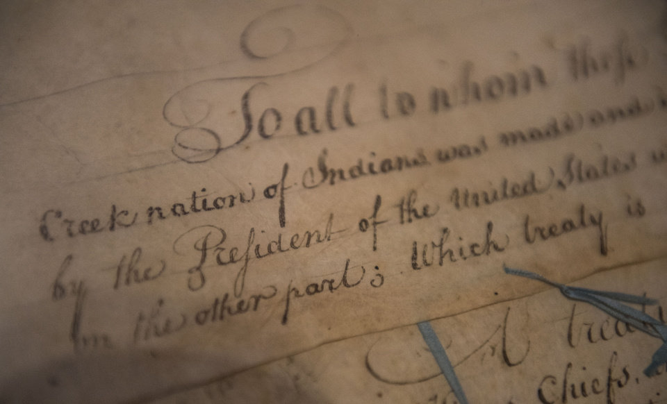 Photo - This March 16, 2015, file photo, shows a detail of the 1790 Treaty of the Muscogee (Creek) Nations and the United States non display at the Smithsonian's National Museum of the American Indian