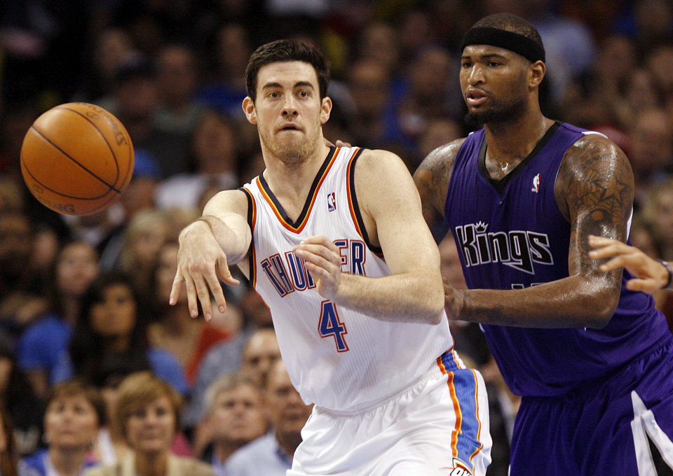 Oklahoma City's Nick Collison (4) passes away from Sacramento's DeMarcus Cousins (15) during the NBA basketball game between the Oklahoma City Thunder and the Sacramento Kings at Chesapeake Energy Arena in Oklahoma City, Friday, April 13, 2012. Oklahoma City won, 115-89. Photo by Nate Billings, The Oklahoman