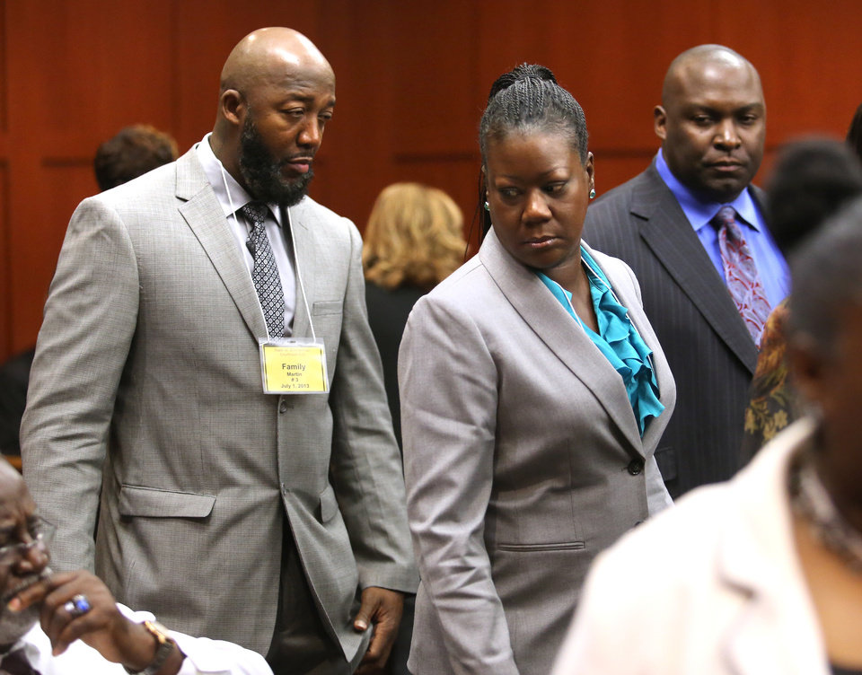 The parents of Trayvon Martin, Tracy Martin, left, and Sybrina Fulton, arrive for the 16th day of the George Zimmerman trial, with their attorney, Daryl Parks, right, in Seminole circuit court, in Sanford, Fla., Monday, July 1, 2013. Zimmerman has been charged with second-degree murder for the 2012 shooting death of Trayvon Martin.(AP Photo/Orlando Sentinel, Joe Burbank, Pool)