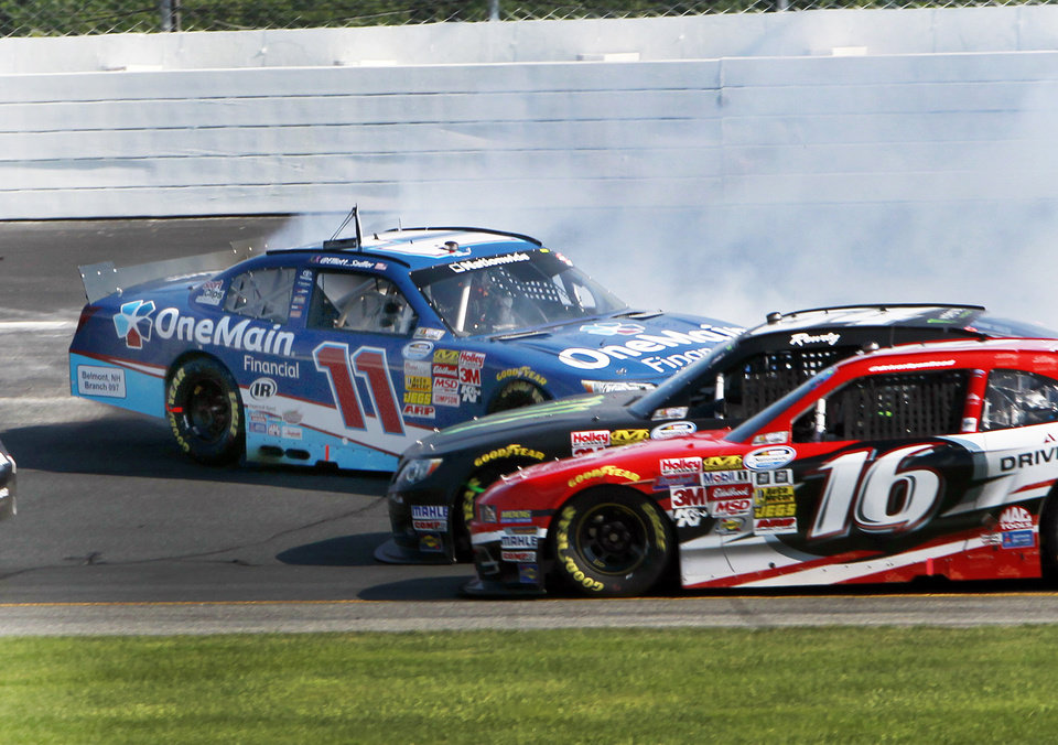 Photo - Ryan Reed (16) and Kyle Busch slide under Elliott Sadler during the NASCAR Nationwide Series auto race at New Hampshire Motor Speedway Saturday, July 12, 2014, in Loudon, N.H. (AP Photo/Jim Cole)