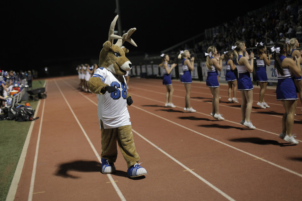 Photo - Deer Creek's mascot walks the sidelines during a high school football game between Deer Creek and Ardmore at Deer Creek Stadium in Edmond, Okla., Friday, Nov. 9, 2012.  Photo by Garett Fisbeck, The Oklahoman