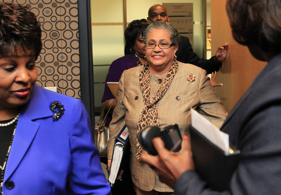 FILE - In this June 13, 2011 file photo, outgoing schools superintendent, Dr. Beverly Hall, center, arrives for her last Atlanta school board meeting at the Atlanta Public Schools headquarters in Atlanta. Hall and nearly three dozen other administrators, teachers, principals and other educators were indicted Friday, March 29, 2013, in one of the nation\'s largest cheating scandals. (AP Photo/Atlanta Journal-Constitution, Curtis Compton) MARIETTA DAILY OUT; GWINNETT DAILY POST OUT; LOCAL TV OUT; WXIA-TV OUT; WGCL-TV OUT