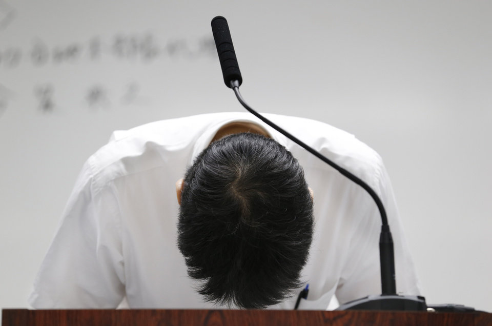 Photo - Tokyo Electric Power Co. spokesman Noriyuki Imaizumi bows during a press conference at the TEPCO headquarters in Tokyo Saturday, Aug. 24, 2013, about new findings of the massive quantity of contaminated water leakage from storage tanks at the tsunami-crippled Fukushim Dai-ichi nuclear power plant. (AP Photo/Koji Sasahara)
